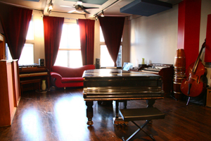 An 1895 Steinway Model A Parlor Grand Piano sits in the center of The Dangerous Room.