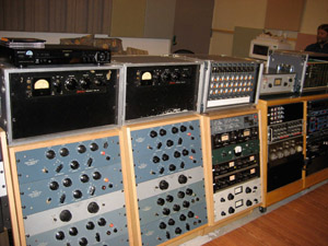 Partial view of Fluxivity's Producer's Desk, featuring Fairchild 660s and plenty of Pultec