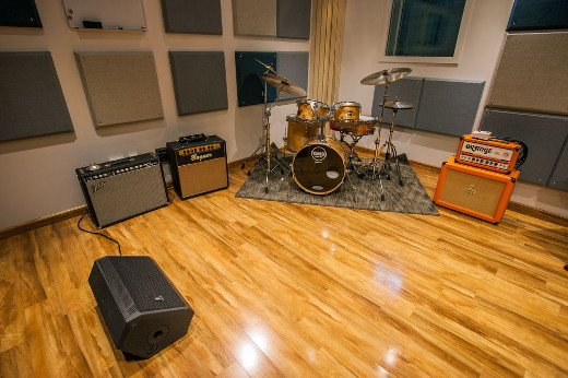 Inside Room ## -- all of the hourly spaces feature GMS drums and Orange amps.