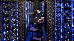 A technician works on one of Google's enormous data centers.