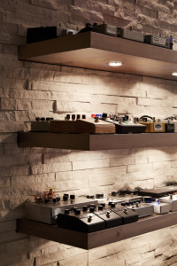 A stone wall adds diffusion and supports custom shelves for a pedal-based effects.